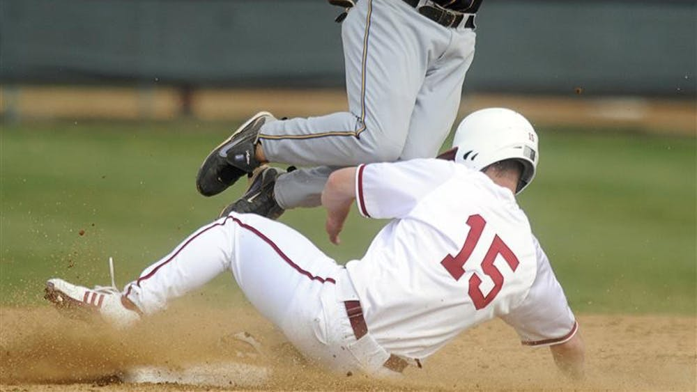 IU senior outfielder Chris Hervey slides into second base in front of Morehead State's Travis Redmon during IU's 18-3 victory over Morehead State on Tuesday at Sembower Field. The Hoosiers face Kentucky on the road today at 4 p.m..