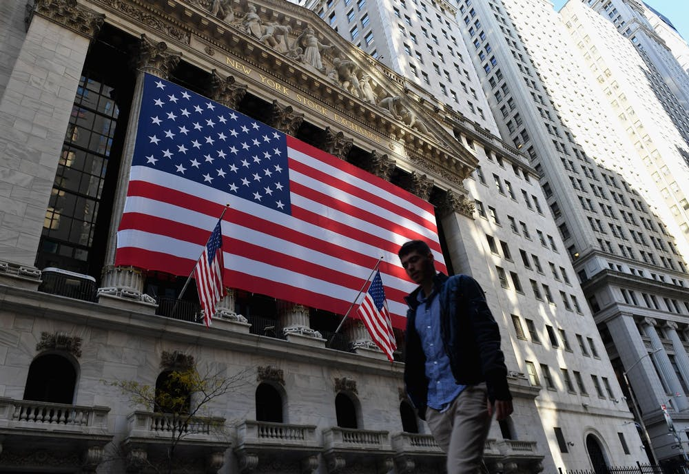 A person walks past the New York Stock Exchange at Wall Street on Nov. 16 in New York City.