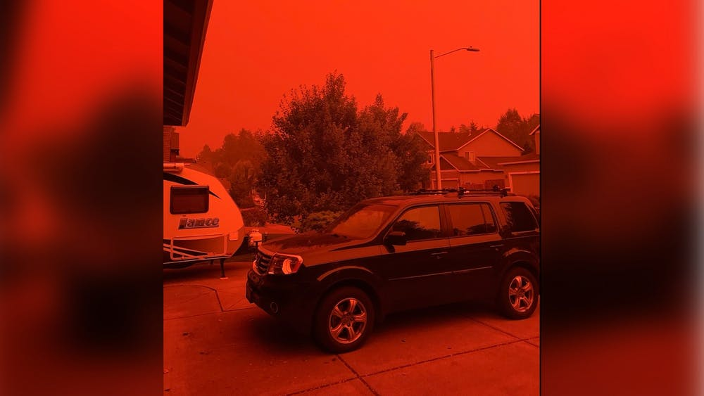 The red sky illuminates Melissa Berry's front yard during the height of the wildfires on the West Coast this month in Salem, Oregon. Wildfire activity in California began escalating Aug. 15.