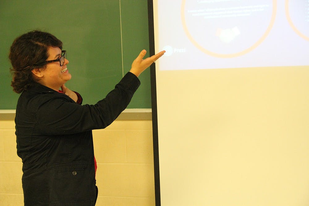 """Sigma Lambda Upsilon senior Yesenia Estrada leads an open discussion about social equality Monday evening. This event was part of the sorority's annual RAICES, or """"roots, week, which followed the theme of """"The Fight for Equality."""""""