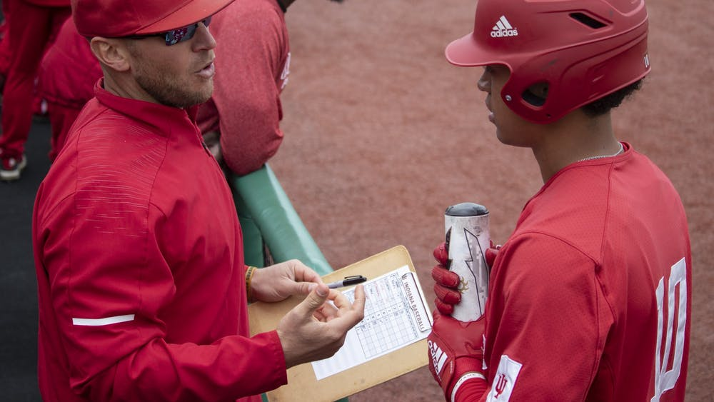 Then-sophomore infielder Justin Walker talks to IU baseball head coach Jeff Mercer at Bart Kaufman Field on April 28, 2019. IU's doubleheader against Penn State was postponed Friday after Mercer tested positive for COVID-19.