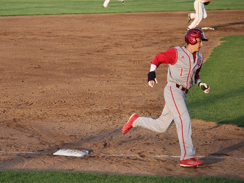 Junior shortstop Nick Ramos rounds third base in an attempt to get home before getting tagged out by an Evansville player on Tuesday night at Braun Stadium. The Hoosiers lost the game 8-4.