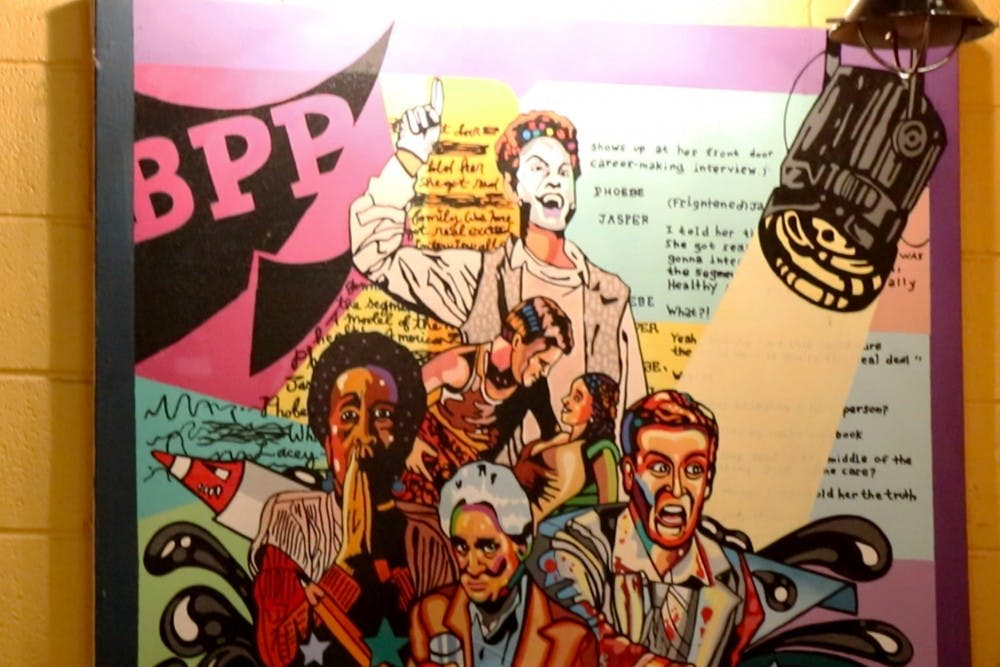 <p>A mural hangs in the lobby of Bloomington Playwrights Project. The building is located at 107 W. Ninth St.</p>
