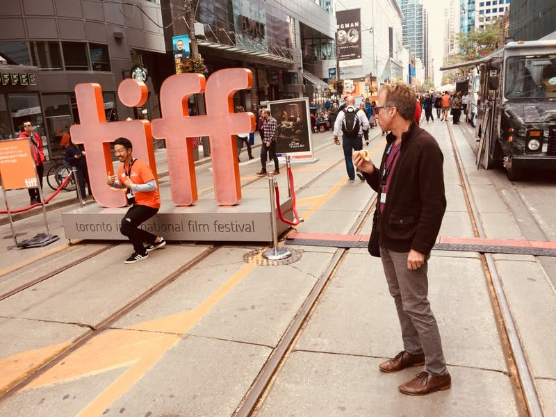 Jon Vickers, the founding director at IU Cinema, stands near a statue at the Toronto International Film Festival.