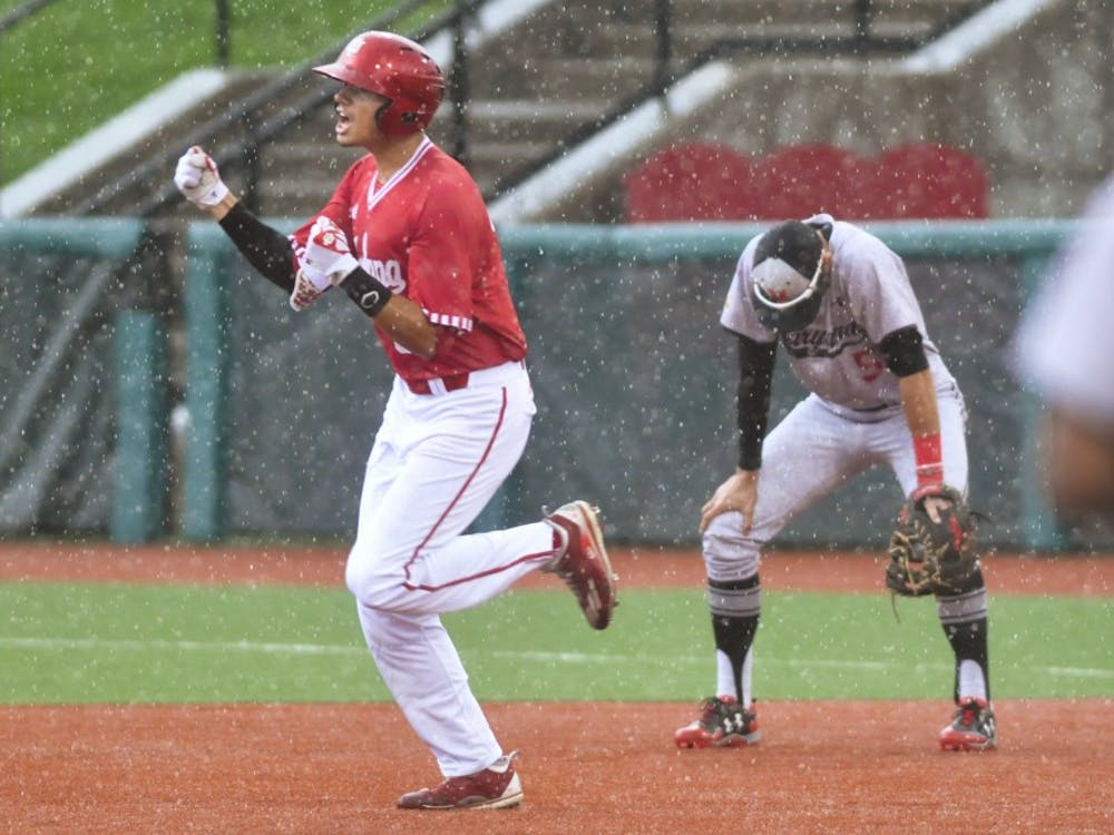 Craig Dedelow hits a grand slam in the rain in the seventh inning of game 3 against Maryland. Dedelow's grand slam gave IU a 6-3 lead immediately before the game entered a weather delay.