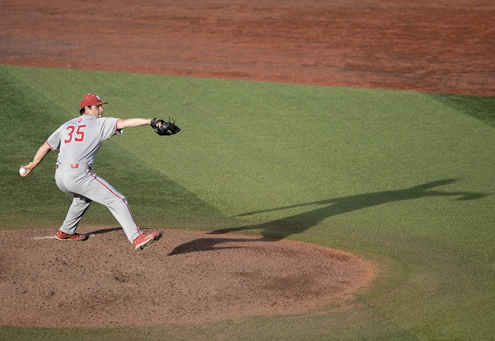<p>Junior pitcher Will Coursen-Carr throws a pitch during a game Tuesday against Indiana State in Terre Haute, Ind. IU went on to lose 6-2.</p>