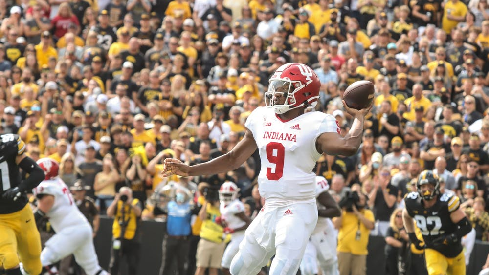 Quarterback Michael Penix Jr. looks to make a pass Sep. 4, 2021, in Kinnick Stadium in Iowa City. The Hoosiers trailed 3-31 at halftime.