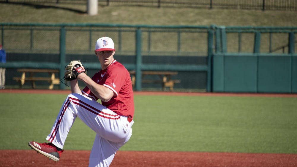 Junior right-hand pitcher Tanner Gordon pitches the ball March 23 at Bart Kaufman Field. IU will play the University of Evansville on April 12-14 in a weekend series.