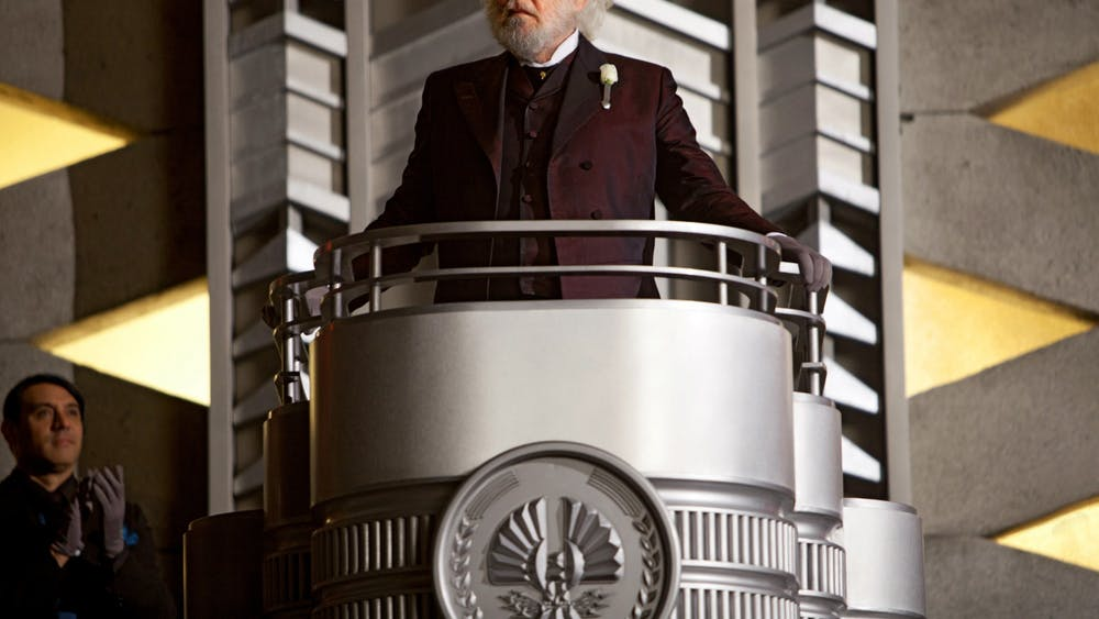 """""""Hunger Games"""" President Snow (Donald Sutherland) stands during a scene in the first Hunger Games movie."""