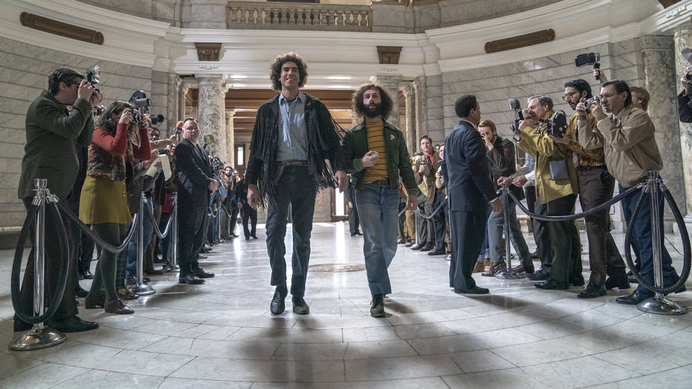 """Sacha Baron Cohen and Jeremy Strong star as Abbie Hoffman and Jerry Rubin in """"The Trial of the Chicago 7."""""""