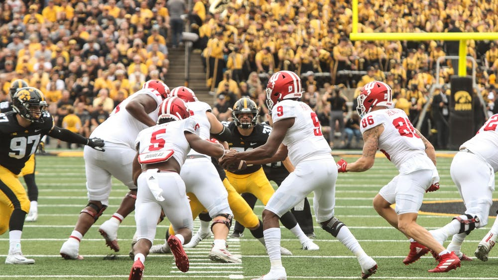 Quarterback Michael Penix Jr. hands the ball to running back Stephen Carr Sep. 4, 2021, in Kinnick Stadium in Iowa City. The Hoosiers fell to Iowa 34-6 in their season opener.