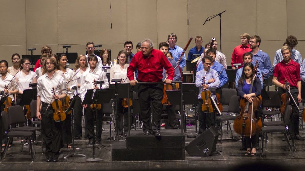 """Conductor David Effron and the orchestra stand to be recognized following the Summer Philharmonic Orchestra on Saturday at the MAC. The Orchestra performed a variety of works including, Tchaikovsky's dramatic """"1812 Overture"""" and Beethoven's Fifth Symphony."""