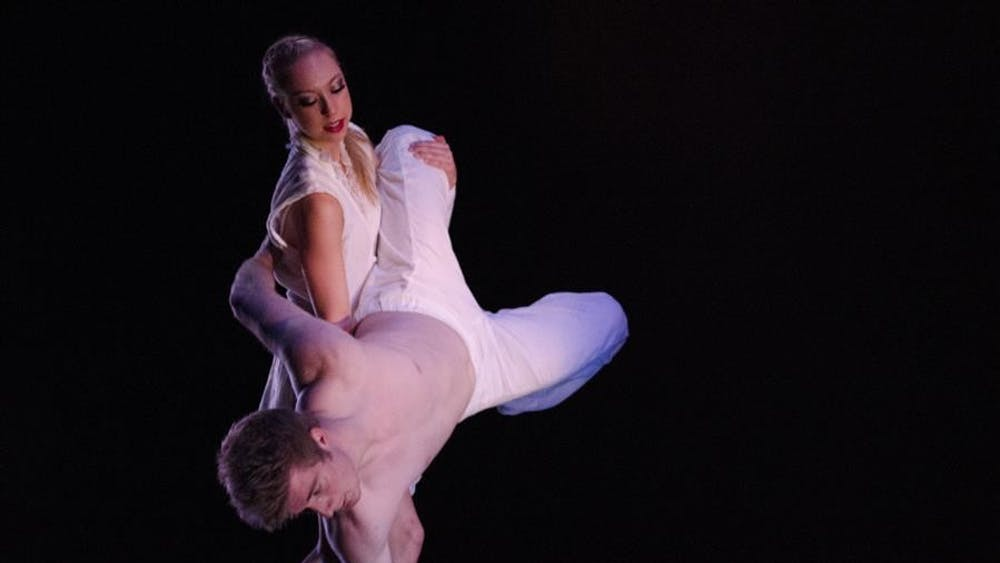 Ryan Galloway and Shannon Kazan perform the piece Minor Bodies on Jan. 16, 2014, for the IU Contemporary Dance Theatre's Winter Dance Concert. The production ran at Ruth N. Halls Theatre.
