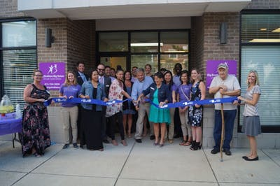 Executive Director Mark Voland cuts the ribbon at the open house for Big Brothers Big Sisters on Tuesday. Big Brothers Big Sisters recently relocated to 501 N Walnut St. (Courtesy Photo of BBBS)