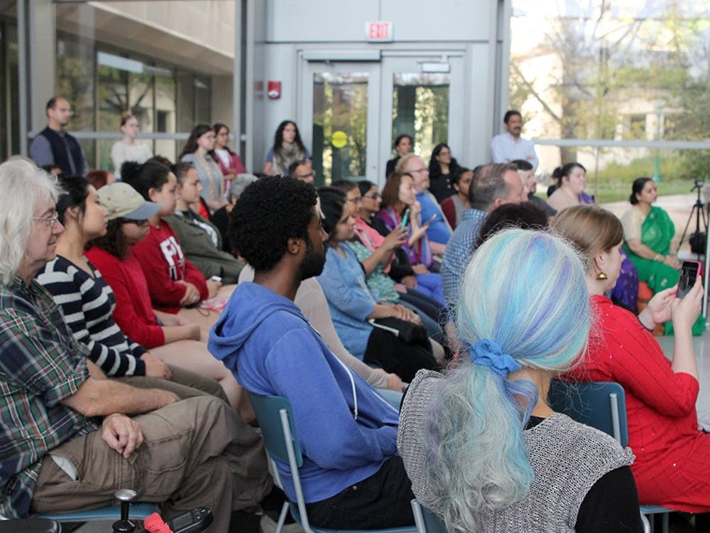 More than 50 people in the Global and International Studies Building atrium watch the traditional Bharatnatyam dance on Tuesday. Tanya Saxena performed for more than an hour.