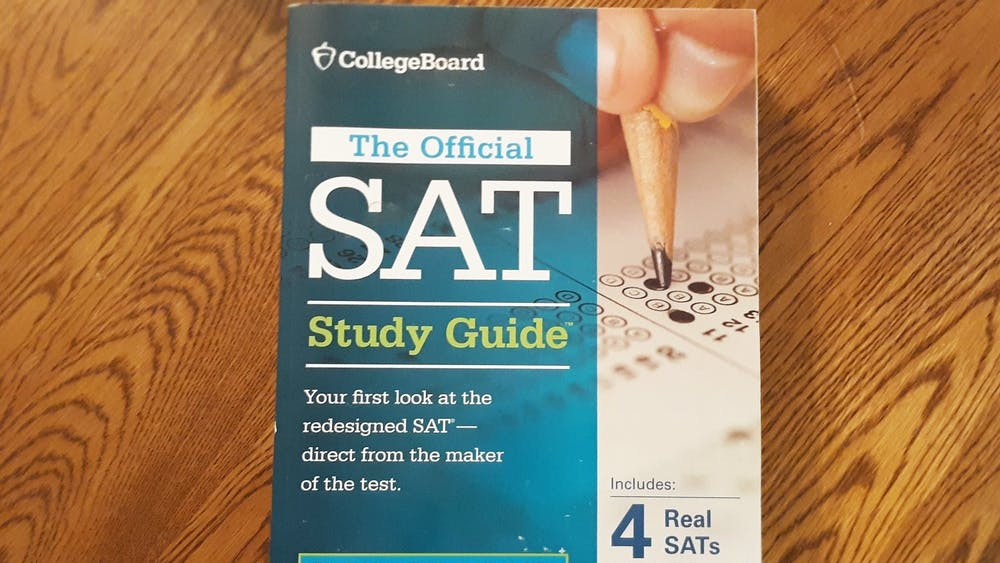 An SAT prep book sits on a table.