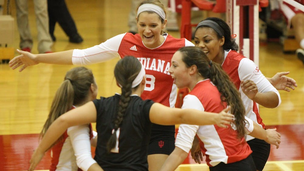 Senior Amelia Anderson celebrates with her team during the Hoosiers' game against Bowling Green on Saturday. IU swept the Indiana Invitational.