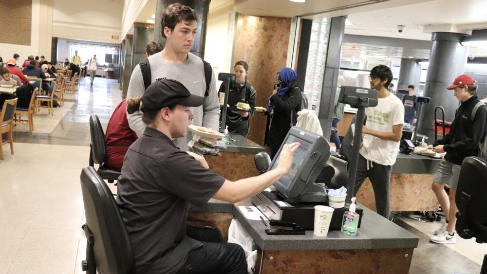 Residential Program Services employees work as cashiers in the food court located in Wright Quad. Any meal points students still have in their accounts for the 2019-20 contract, which goes through May 9, 2020, will be valid through May 8, 2021, according to an email sent to students Wednesday.