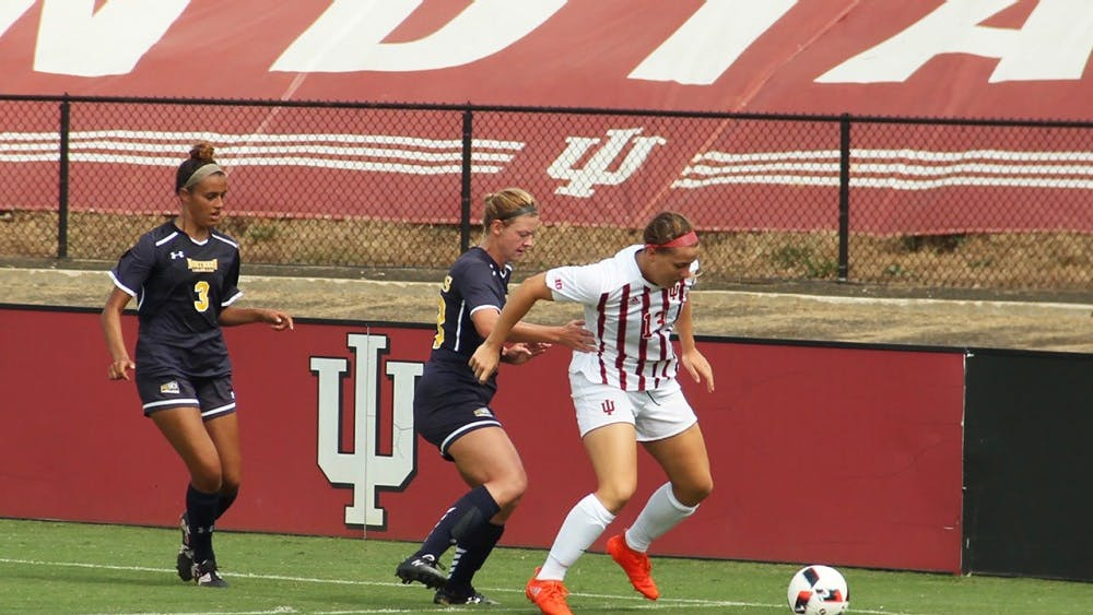 Indiana University Women Soccer (IUWS) Forward, Maya Piper, defends the ball from the opponents, Northern Colorado Sunday at the Armstrong Stadium.