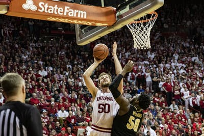Junior center Joey Brunk shoots the ball in the second half against Purdue on Feb. 8 in Simon Skjodt Assembly Hall. IU will take on Purdue Thursday in West Lafayette, Indiana.