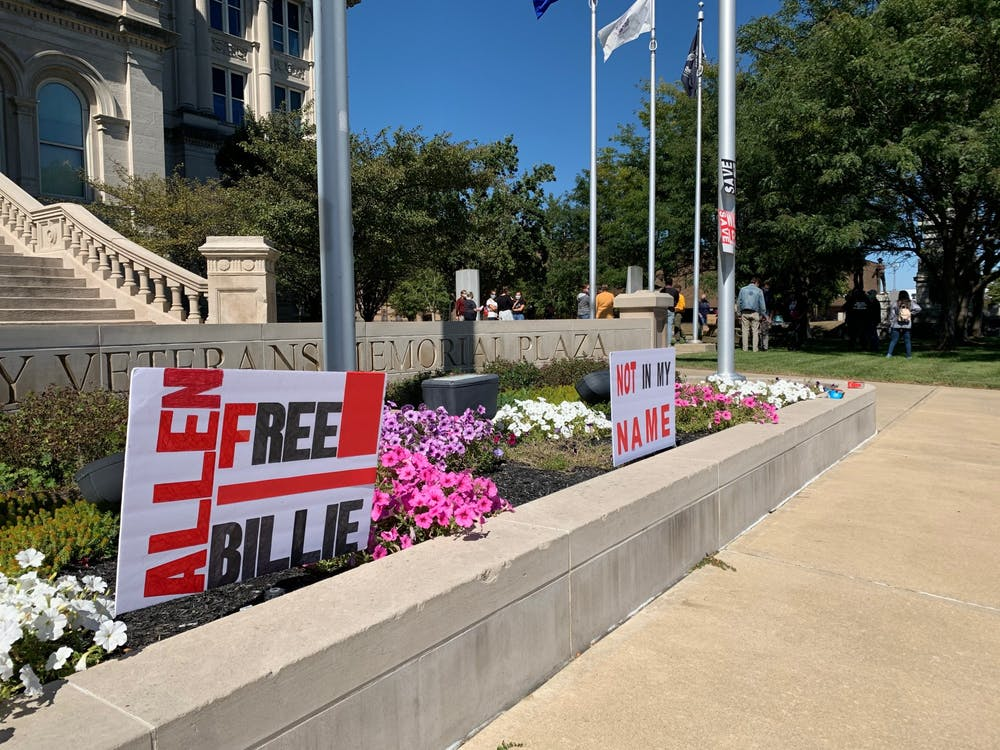 Signs with messages protesting the federal execution of Billie Allen are seen in front of the Vigo County Courthouse on Sept. 20 in Terre Haute, Indiana. Allen was convicted and sentenced to the federal death penalty for a 1997 armed robbery and murder of bank security guard Richard Heflin in St. Louis, Missouri, despite no forensic evidence tying him to the crime.