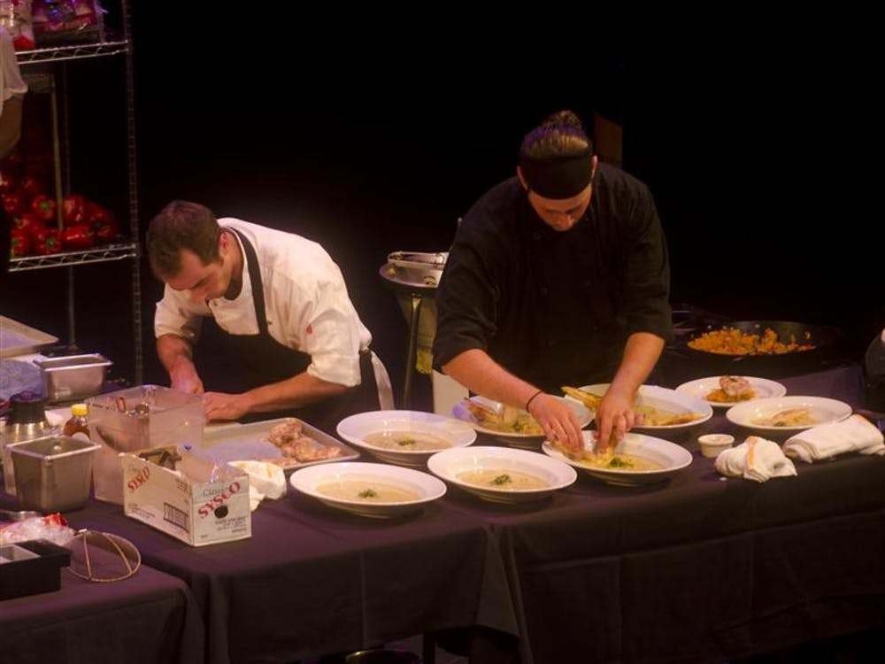 Chef Lake Hubbard of Uptown Cafe and his sous-chef plate their honey curried squash soup during the 5th Annual Chef's Challenge Sunday at the Buskirk-Chumley Theater.