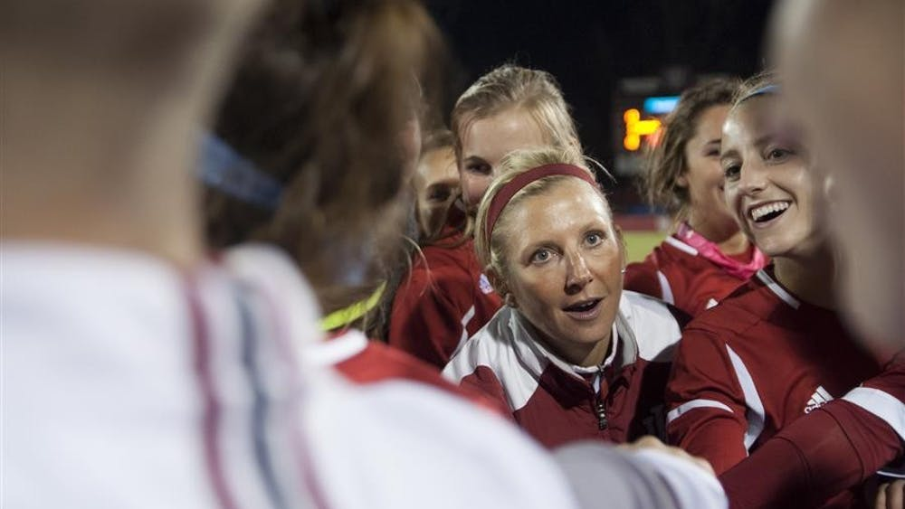 Head coach Amy Berbary talks to the team after the match against DePaul on Saturday at Bill Armstrong Stadium.