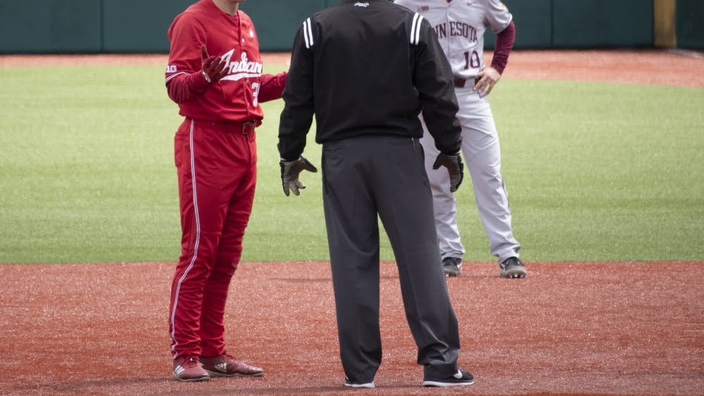 Junior infielder Scotty Bradley talks to an umpire about a call Sunday at Bart Kaufman Field. Bradley reached on an error by third base at the bottom of the first inning against Minnesota.