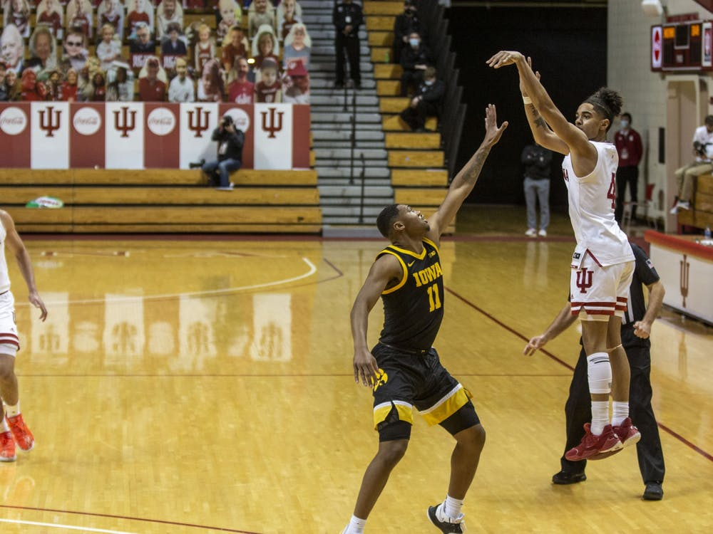 Freshman guard Khristian Lander attempts a 3-point shot Feb. 7 at Simon Skjodt Assembly Hall. IU will take on No. 4 Ohio State at noon Saturday.