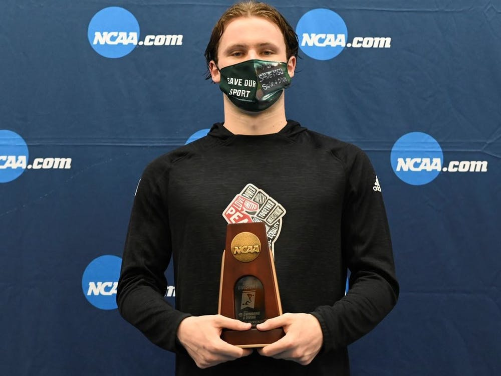 Sophomore Brendan Burns poses on the podium Saturday at the NCAA Championships in Greensboro, North Carolina. Burns finished in seventh place in the 200 meter butterfly, contributing to a sixth place finish for the No. 9 ranked IU men's swimming and diving team Saturday.