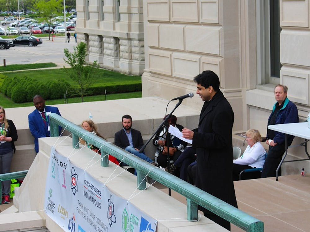 Jesse Kharbanda of the Hoosier Environmental Council rallies the crowd on Saturday. Kharbanda encouraged attendees at the March for Science to start science-related discourse with their political representatives.