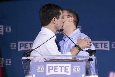 Pete Buttigieg, mayor of South Bend, Indiana, kisses his husband, Chasten, on April 14, 2019, in South Bend, Indiana.