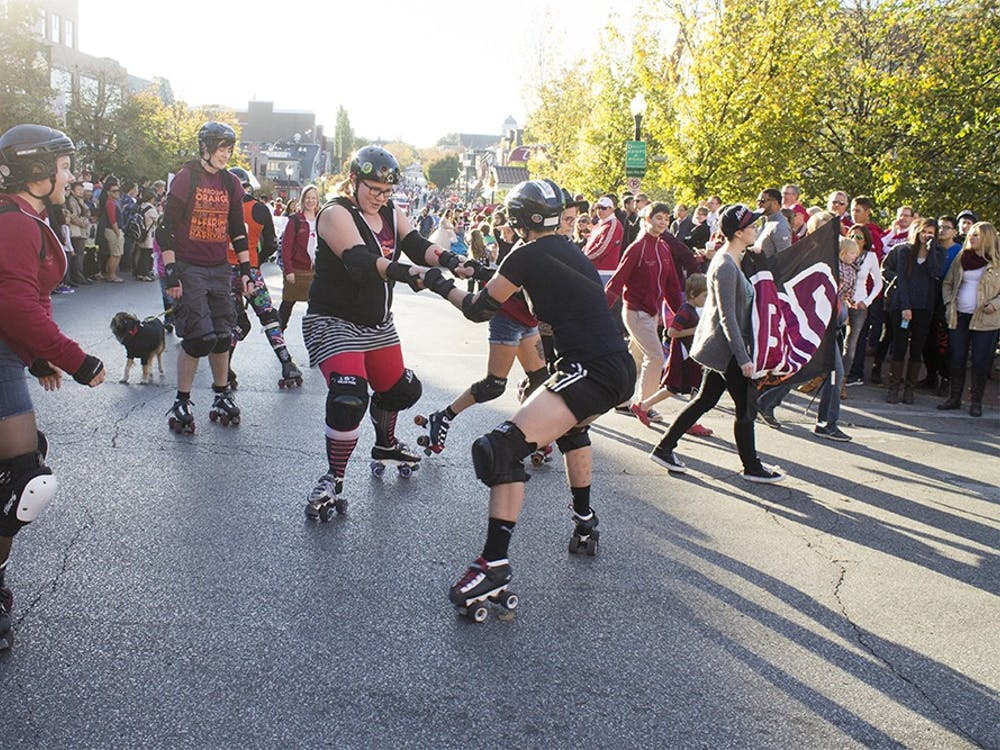 The Bloomington Heartland Roller Derby skates around during the homecoming parade on Friday.