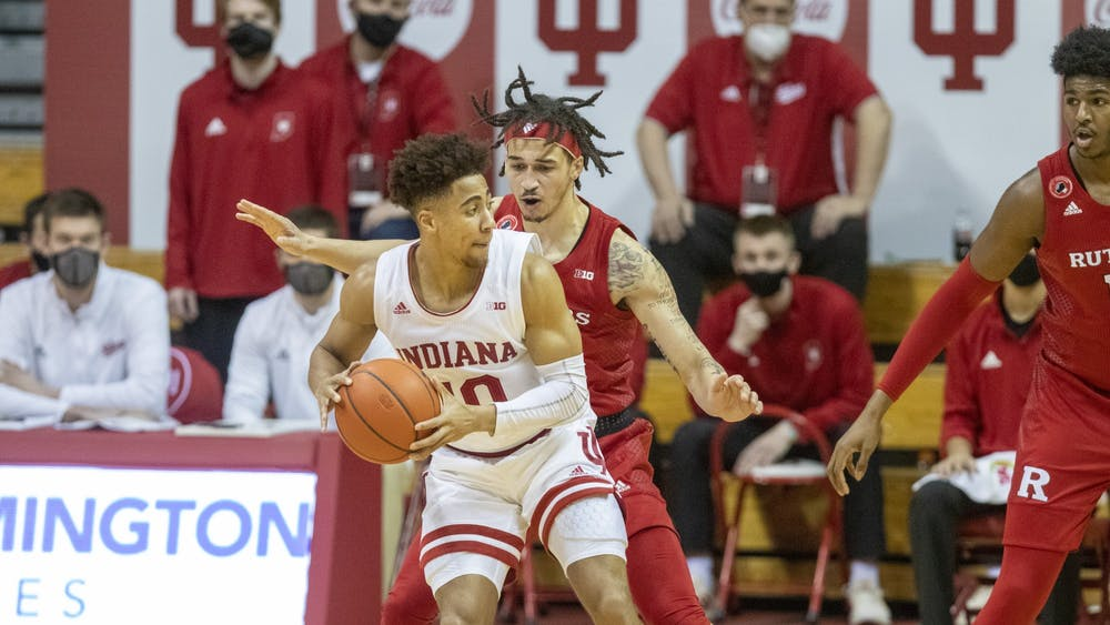 Junior Rob Phinisee goes to pass the ball Jan. 24 in Simon Skjodt Assembly Hall. IU lost to Rutgers 74-63 Wednesday.