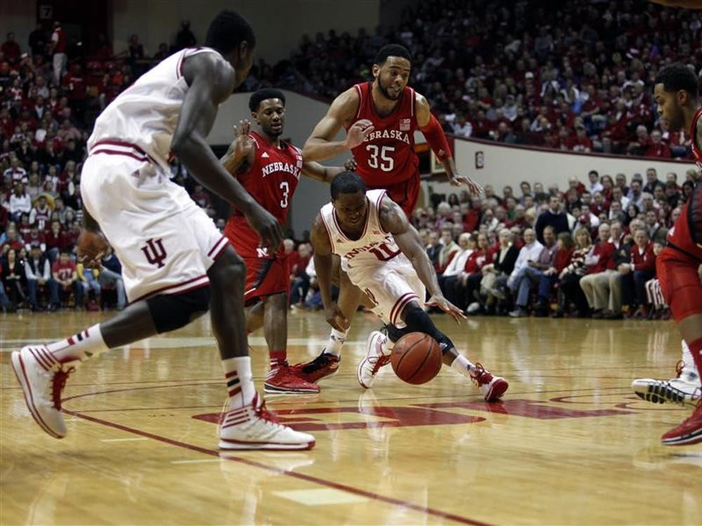 """Kevin """"Yogi"""" Ferrell struggles to control the ball during the game against Nebraska on Thursday at Assembly Hall. It was the Hoosiers last home game of the regular season."""