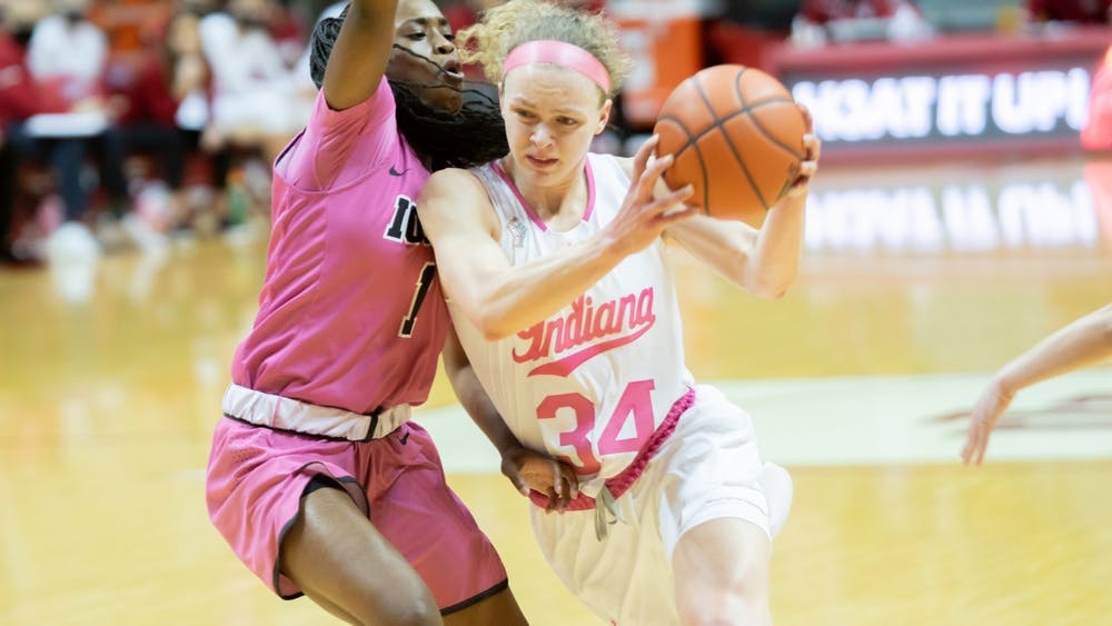 Then-junior guard Grace Berger drives against the Iowa defense at Simon Skjodt Assembly Hall on March 3, 2021. Women's Excellence is aimed to support IU's female athletes through various development opportunities.