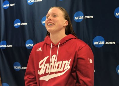 Lilly King talks to the media after winning the 200-yard breaststroke on the final night of the NCAA Tournament. King is the winningest breaststroke swimmer in NCAA history.