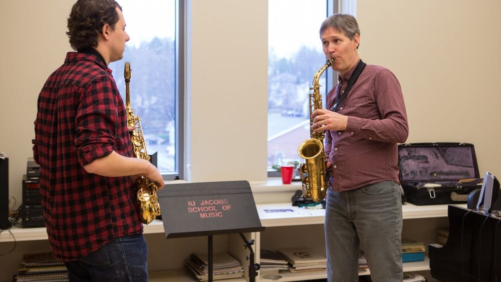 Thomas Walsh, professor of music and department chair of jazz studies, coaches a Jacobs School of Music student.