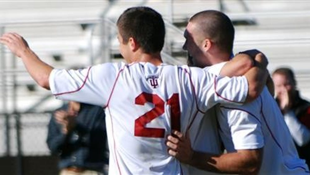 Junior forward Andy Adlard runs to embrace junior midfielder Daniel Kelly, senior forward Darren Yeagle and sophomore forward Will Bruin after Yeagle's goal in the second half of IU's 2-0 victory against Wisconsin. Yeagle scored about 20 minutes after Bruin's goal that opened the half.