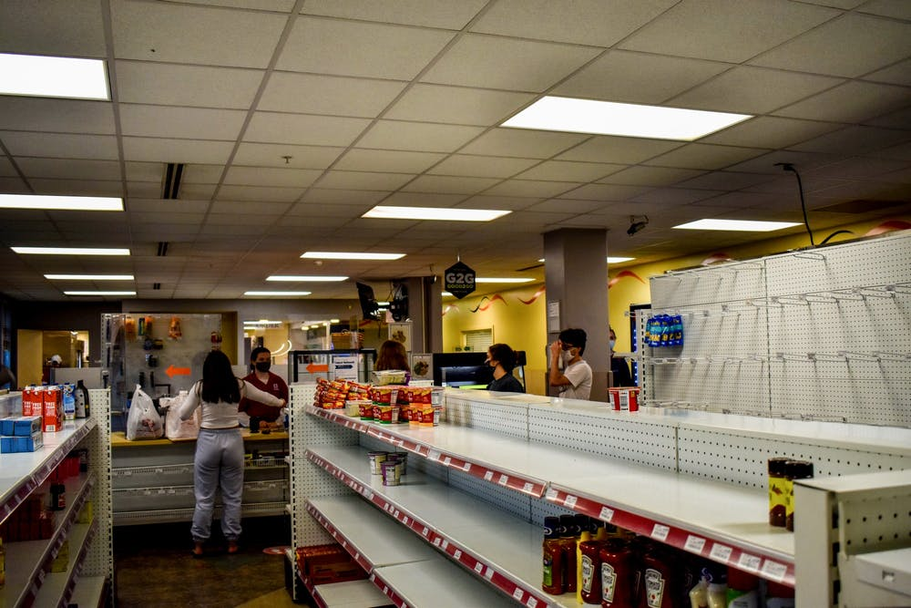 <p>Students check out at the Eigenmann Hoosier C-store on May 3 before moving out for the summer. Students who still have I-Bucks remaining are encouraged by local food banks to buy food for donation.</p>