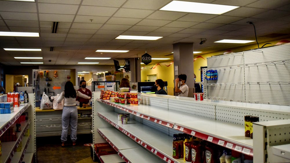 Students check out at the Eigenmann Hoosier C-store on May 3 before moving out for the summer. Students who still have I-Bucks remaining are encouraged by local food banks to buy food for donation.