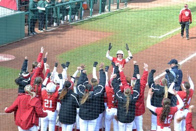 The IU softball team celebrates as Grayson Radcliffe returns back to home base March 31 after hitting a home run in the second game of a double header versus Michigan State University. IU will play the University of Michigan on April 5-7.