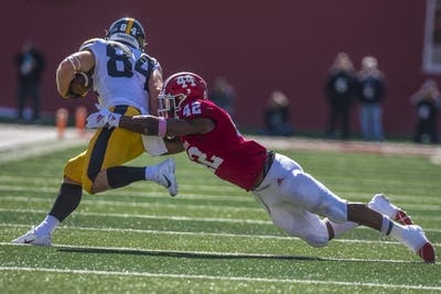Sophomore defensive back Marcelino Ball attempts to tackle senior Iowa wide reciever Nick Easley during the homecoming game Oct. 13 at Memorial Stadium. IU will face Penn State on Saturday.