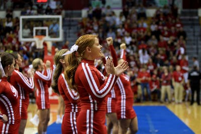 Cheerleaders attempt to excite the crowd during the 2018 Hoosier Hysteria in Simon Skjodt Assembly Hall. The IU Crimson all-girl cheerleading team won its sixth national championship title Sunday night.