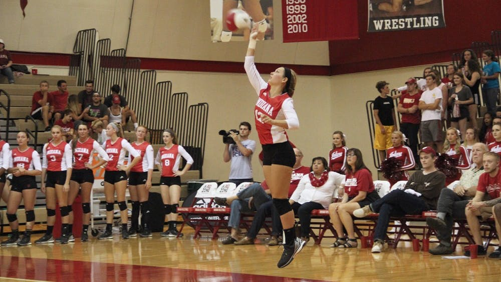 Samantha Fogg, Indiana University sophomore, serves the ball during volleyball competition against the Northwestern on Wednesday.