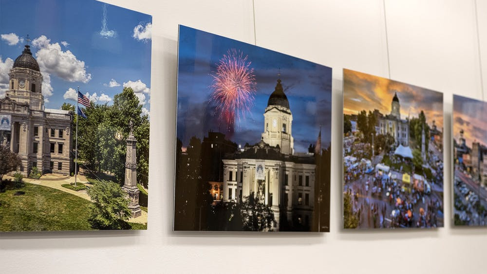 Photographs featured in Gallery Walk Bloomington's upcoming event are displayed on a wall. Gallery Walk Bloomington's fourth gallery walk of the year will take place 5-8 p.m. Friday, April 2, and will feature two new art galleries.
