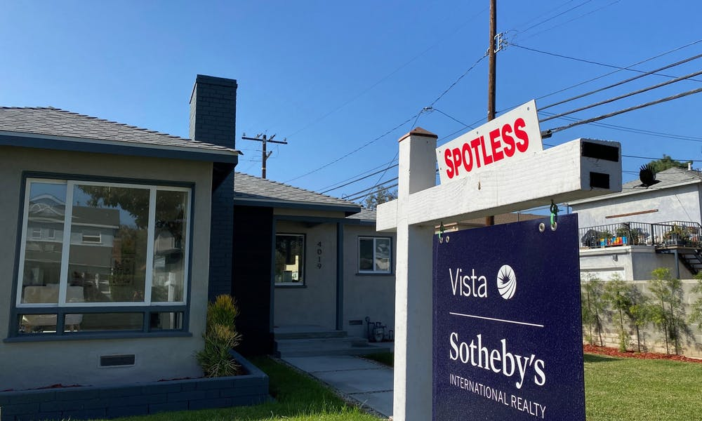 <p>A real estate sign is seen in front of a house for sale Nov. 19, 2020, in West Los Angeles.</p>