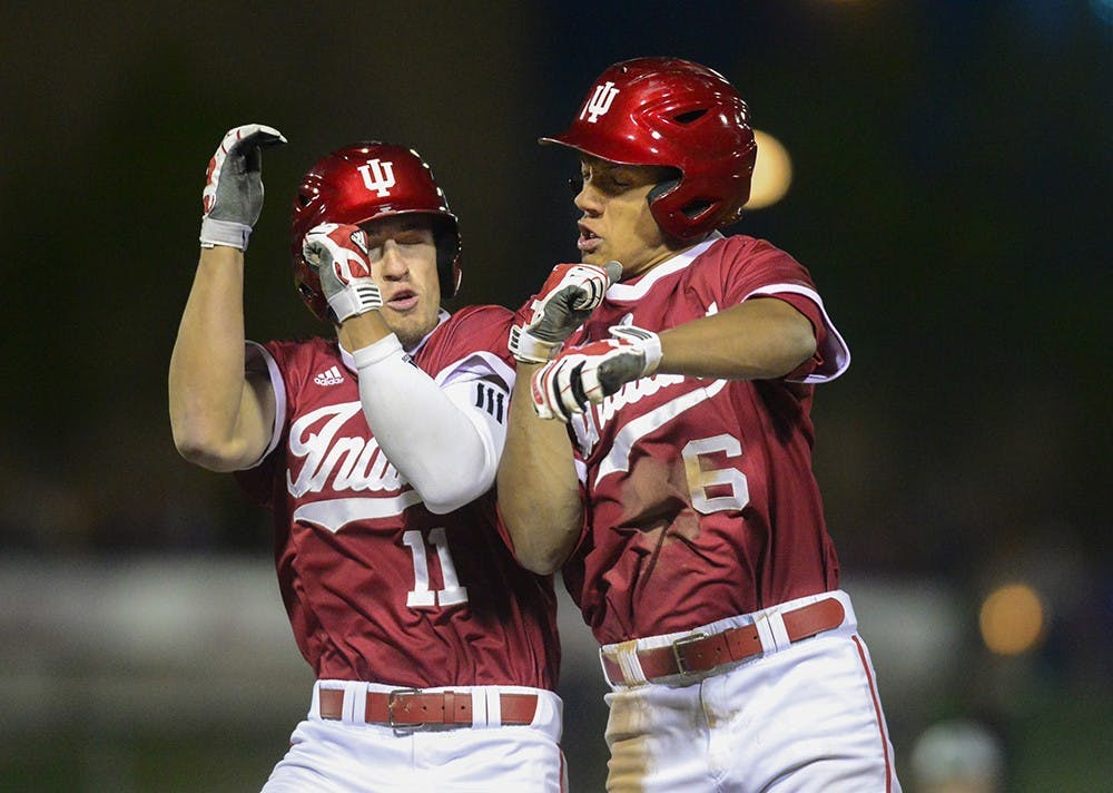 Senior Will Nolden celebrates with freshman Isaiah Pasteur after the Hoosiers beat Notre Dame on Tuesday at Victory Field in Indianapolis. Pasteur's hit allowed Nolden to score from second base, resulting in a walk-off.