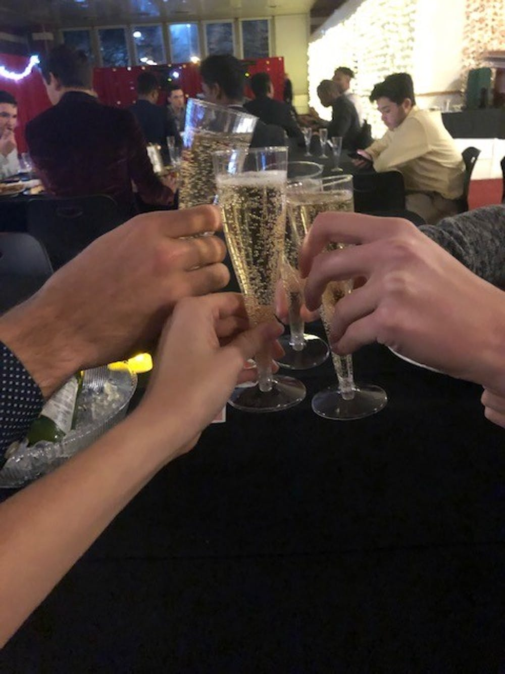 <p>McNutt Quad residents attend the Holly and Ivy dinner dance Dec. 6, 2018 . The dance was certified as a Green Event by Sustain IU for making environmentally friendly decisions like using reusable dinner ware and decorations.</p>