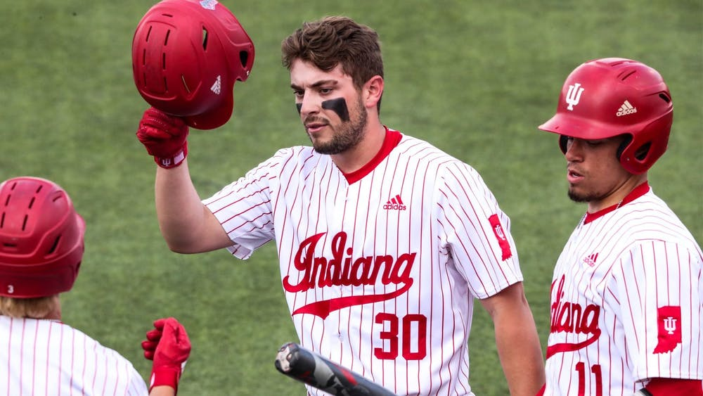 Freshman Kip Fougerousse puts on his helmet during the game against Northwestern on Friday in Evanston, Illinois. The Hoosiers won 5-4 Saturday and lost 5-8 Sunday.